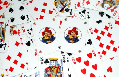 Two jokers on playing cards background