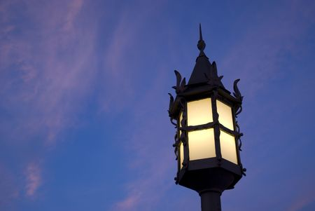 Old street lamp over a beautiful sunset photo
