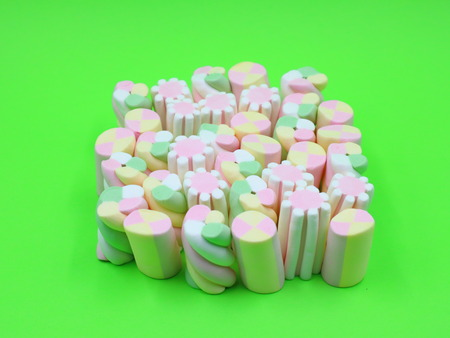 Colorful Marshmallows on Green Background Stock Photo