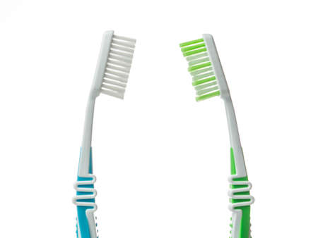 Two toothbrushes on a white background.