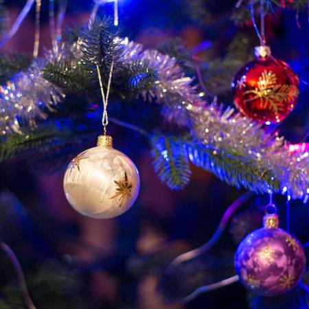 Christmas toys balls hanging on the tree