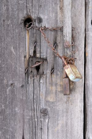 Old rusty provisional lock on a wooden door Stock Photo - 852111