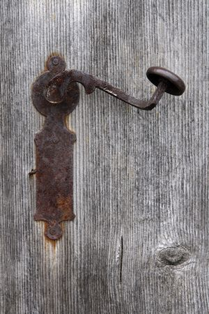 Old fashioned and rusty door knob on a wooden door Stock Photo - 852112