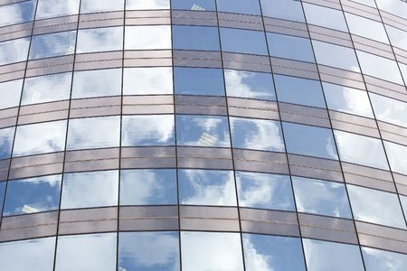 Glassy facade of a office building with sky reflection Stock Photo - 2712968