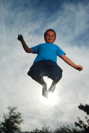 little boy jumping high photo