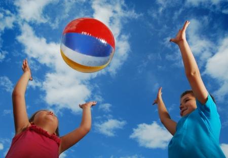 beach ball play at summertime photo