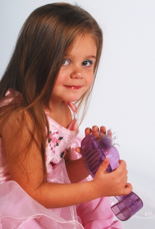 Cute little girl in pink dress and shoe