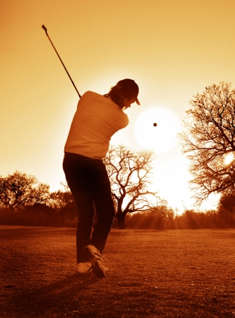 Sunset Golf   Golfer playing stroke into the setting sun