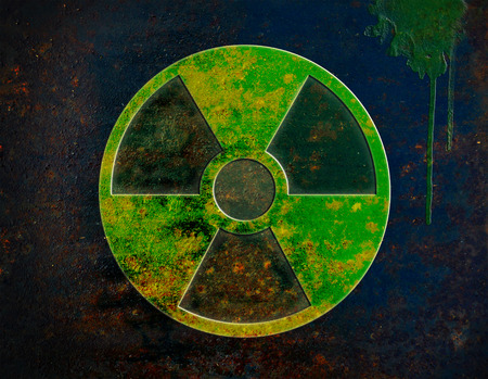 uranium: radiation sign on dark rusty metal plate Stock Photo