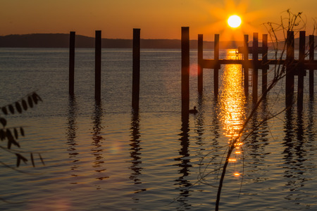 waterscapes: Orange sunrise, reflected on the water