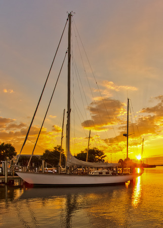 waterscapes: Sailboat in golden glow