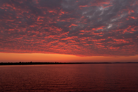 waterscapes: Colorful textured sunrise over the water Stock Photo
