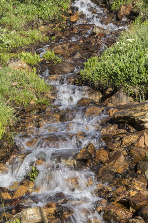 waterscapes: Snow-melt stream forming a small waterfall Stock Photo