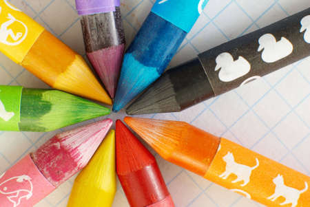 Colorful drawing pencils. Nine wax coloured crayons.