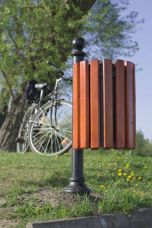 Dustbin, willow tree and bicycle. Stock Photo