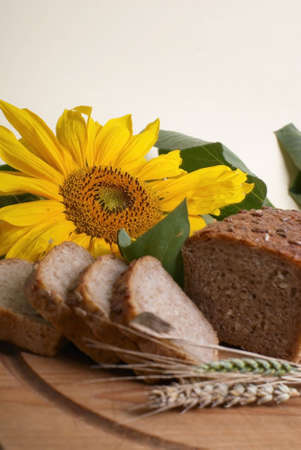 Brown bread with sunflower. Stock Photo