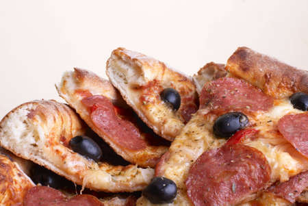 Pizza of salami, cheese and olives. Stock Photo