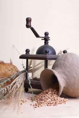 Still life with clay pitcher and pepper mill. Stock Photo