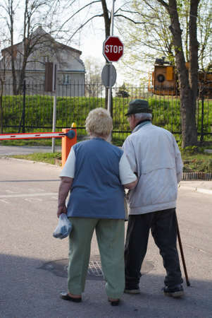 Old couple walking together in park Stock Photo