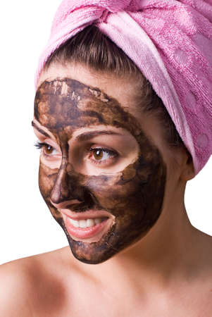 Beautiful girl with mud mask on face photo