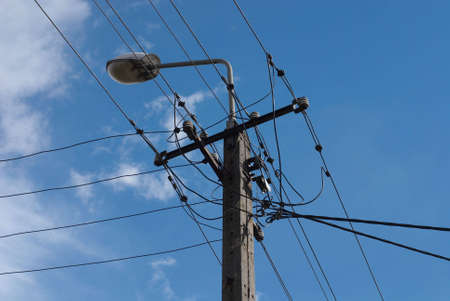 Electrical power lines on blue sky background. Stock Photo