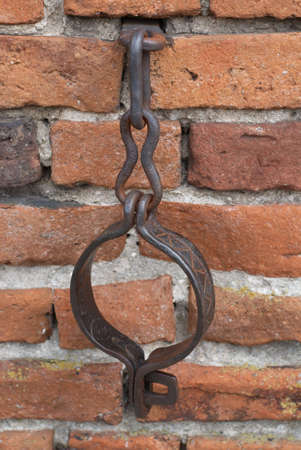 Original medieval handcuffs in  church wall. XVII-XVIII century. City Myszyniec - Poland. photo