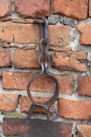 Original medieval handcuffs in  church wall. XVII-XVIII century. City Myszyniec - Poland. Stock Photo