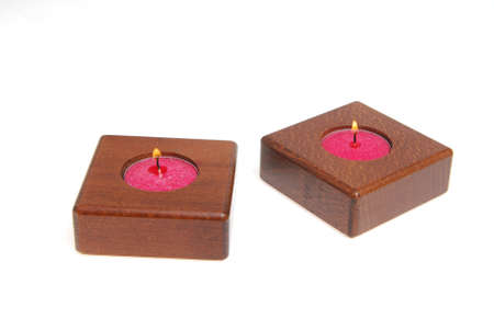 Two wooden candlesticks isolated on white background.
