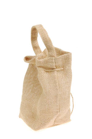 Small beige textured sack. Isolated on white bacground.