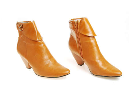 Pair brown, woman shoes from collection autumn - winter. Isolated on white background.