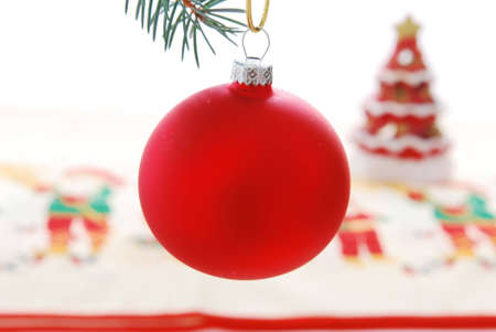 Red Christmas ball on xmas background.