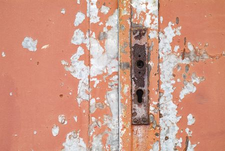 Grunge Background corroded door locker chiped off red paint photo