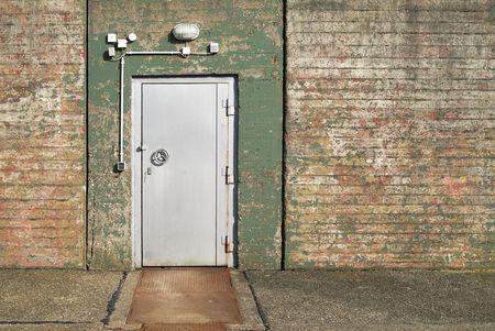 rusty background: entrance of a forsaken bunker with steel door