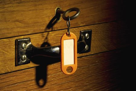 old desk locker with key and badge, free copy space, grunge photo