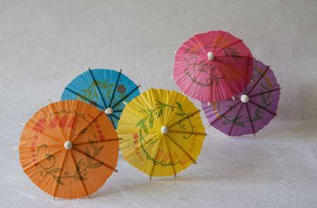 Set of multicolored small paper umbrellas photo