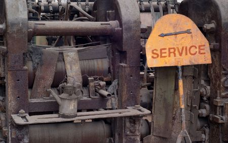 broken vintage machines with metal sign Service, including an arrow, free copy space photo