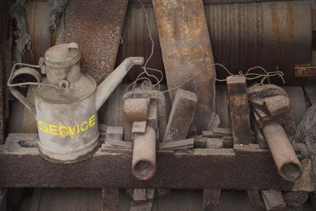 Industrial still life with an old oil can, wearing the caption  photo