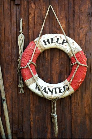 A rotten Life saver with caption help wanted photo