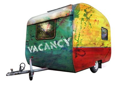 A multicolored painted  trailer with caption Vacancy, grungy photo