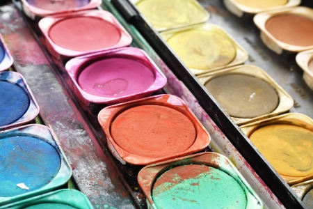 unleashed: Paint box with splatters, unleashed colors, artist toolbox; close up Stock Photo