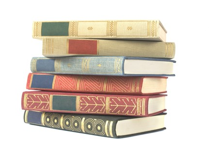 hardback: stack of vintage books isolated on white background, blank labels, free copy space