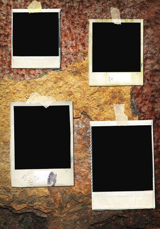 Blank,battered instant picture frames, on a rusty iron wall,free space for pix Banco de Imagens