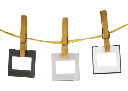 blank slides hanging on a rope,white background, freey copy and pix space Banco de Imagens