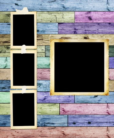 Vintage photographic blank picture frames on multicolored wooden background photo