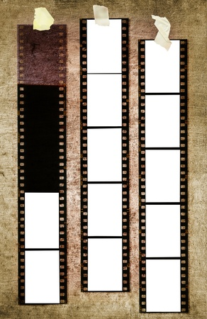 35: 35 mm filmstrip, picture frames, on grungy background