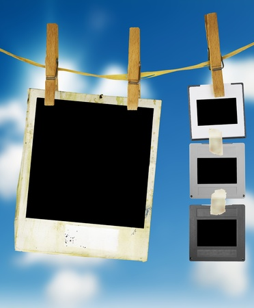Slides and an instant picture hanging on a rope, freey space for pix Banco de Imagens