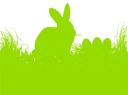 text free space: easter bunny witn eggs in the grass, background
