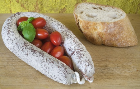 Salami with bread, tomatoes and basil, rustic ifood photo
