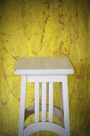 home accents: vintage empty stand against grungy background