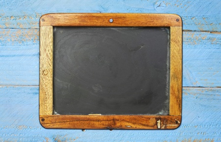 vintage school blackboard on painted wooden wall, free copy space